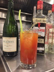 A Bloody Mary made with beet-infused gin and topped with sparkling wine.