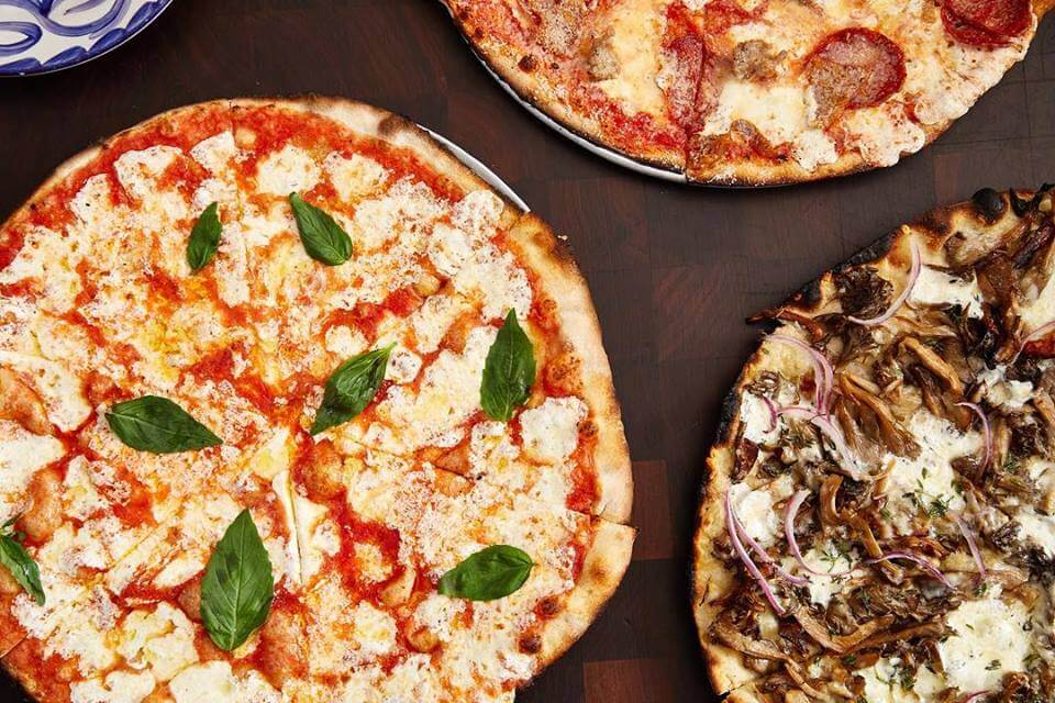 Your perfect match with New Year's Eve Champagne is pizza at Marta.
