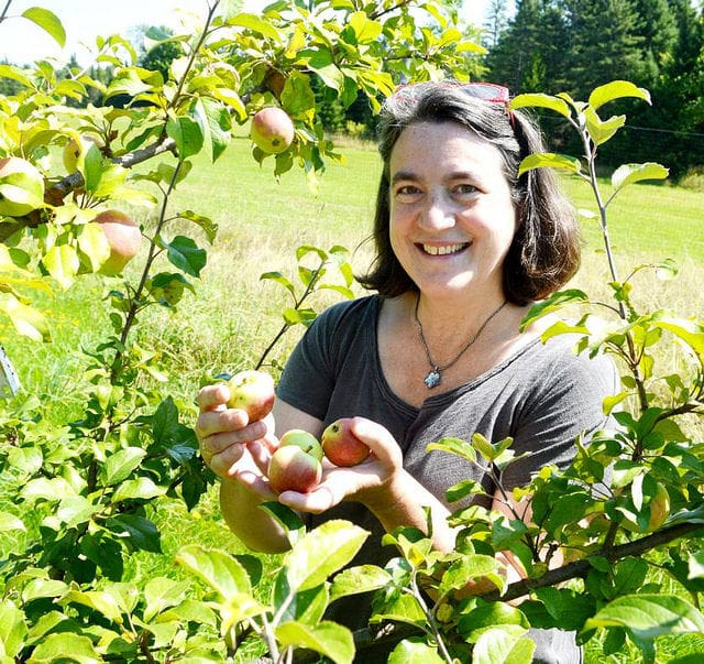 Eleanor Léger in the apple orchard.