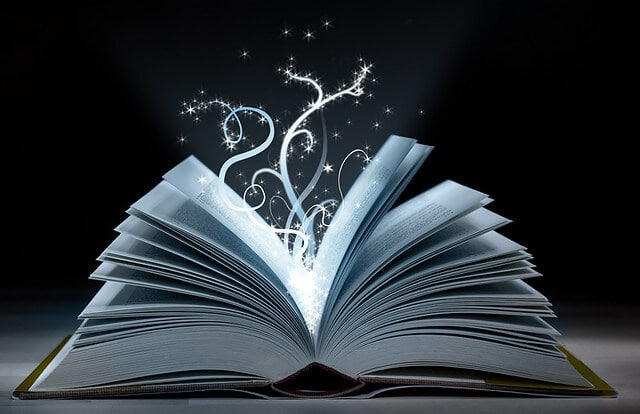 A magic book that's open and a spell's coming out of it