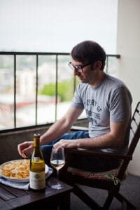 Jameson Fink with wine and chips